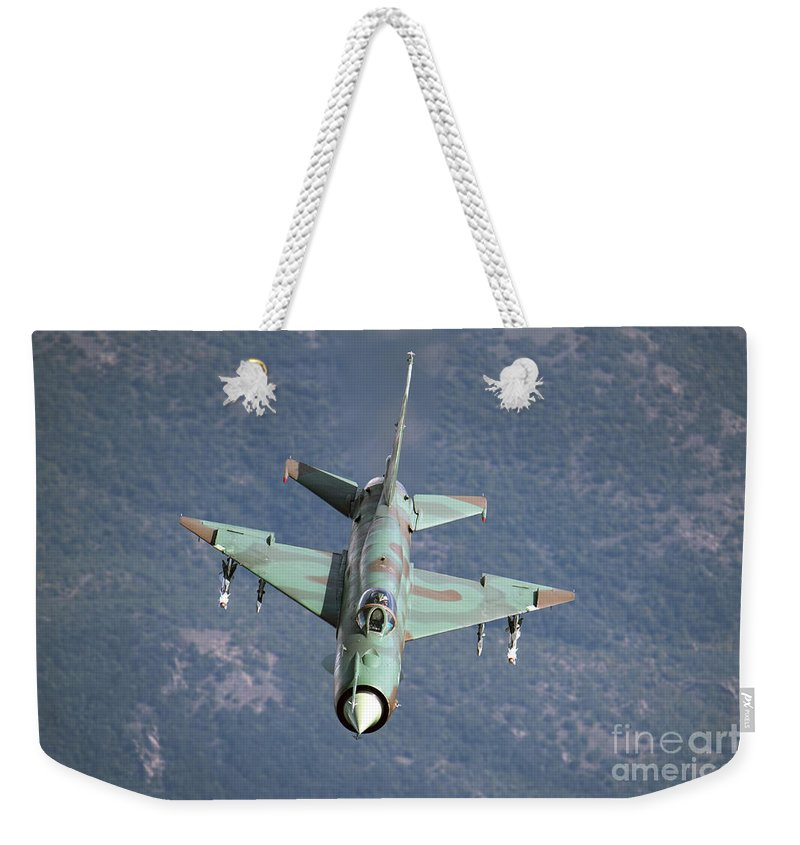 Horizontal Weekender Tote Bag featuring the photograph A Bulgarian Air Force Mig-21bis Armed by Daniele Faccioli