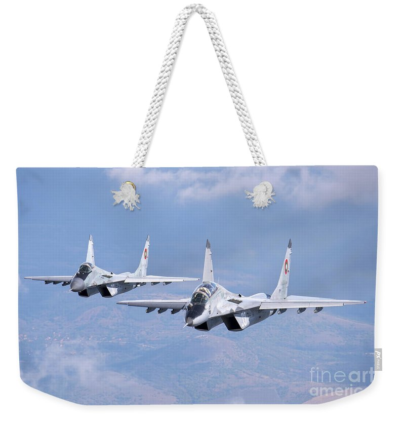 Horizontal Weekender Tote Bag featuring the photograph A Pair Of Bulgarian Air Force Mig-29s by Daniele Faccioli