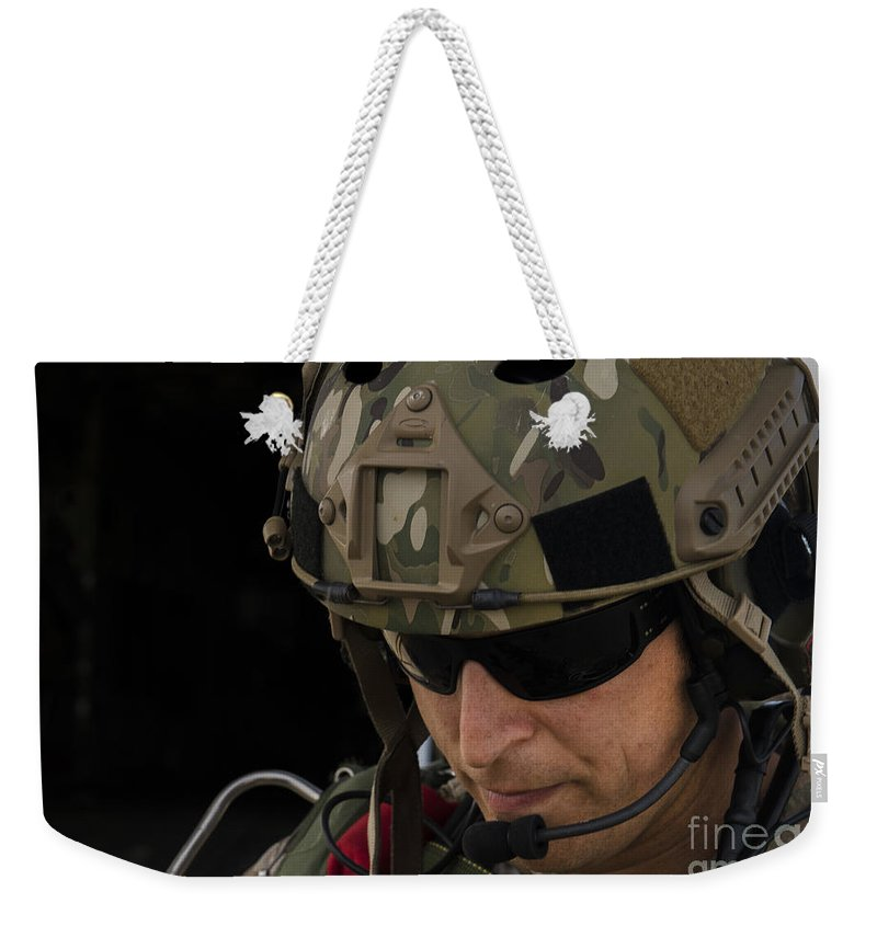 Exercise Emerald Warrior Weekender Tote Bag featuring the photograph A U.s. Air Force Combat Controller by Stocktrek Images