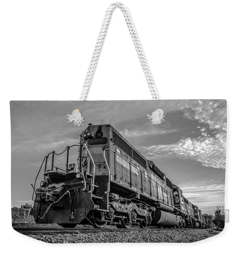 B&w Weekender Tote Bag featuring the photograph Blue Freight Train Engine At Sunrise by Alex Grichenko