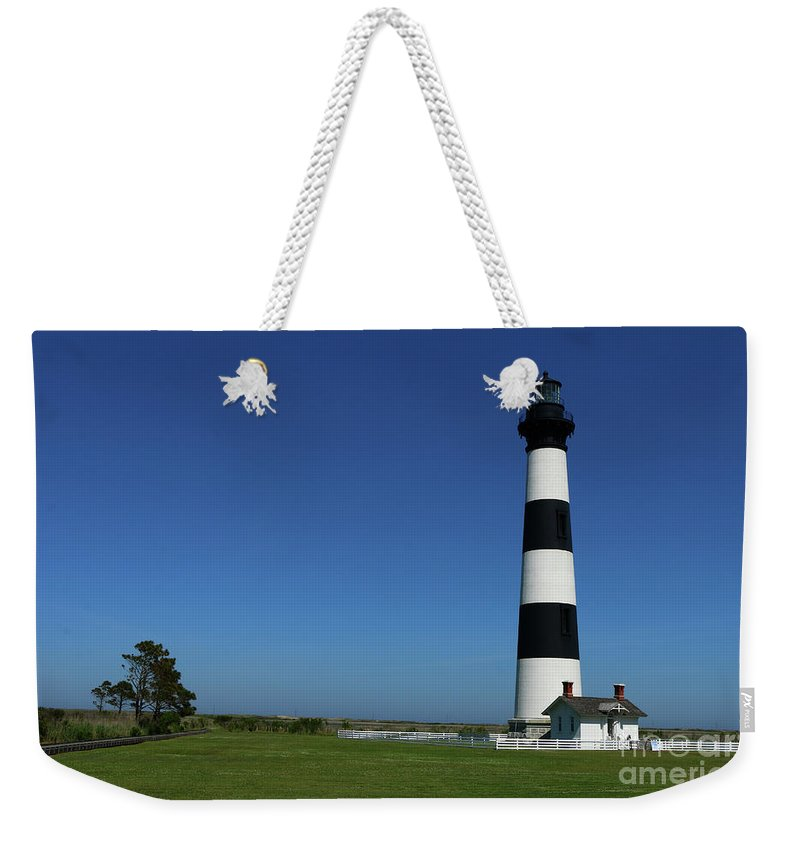 Bodie Lighthouse Weekender Tote Bag featuring the photograph Bodie Island Lighthouse by Christiane Schulze Art And Photography