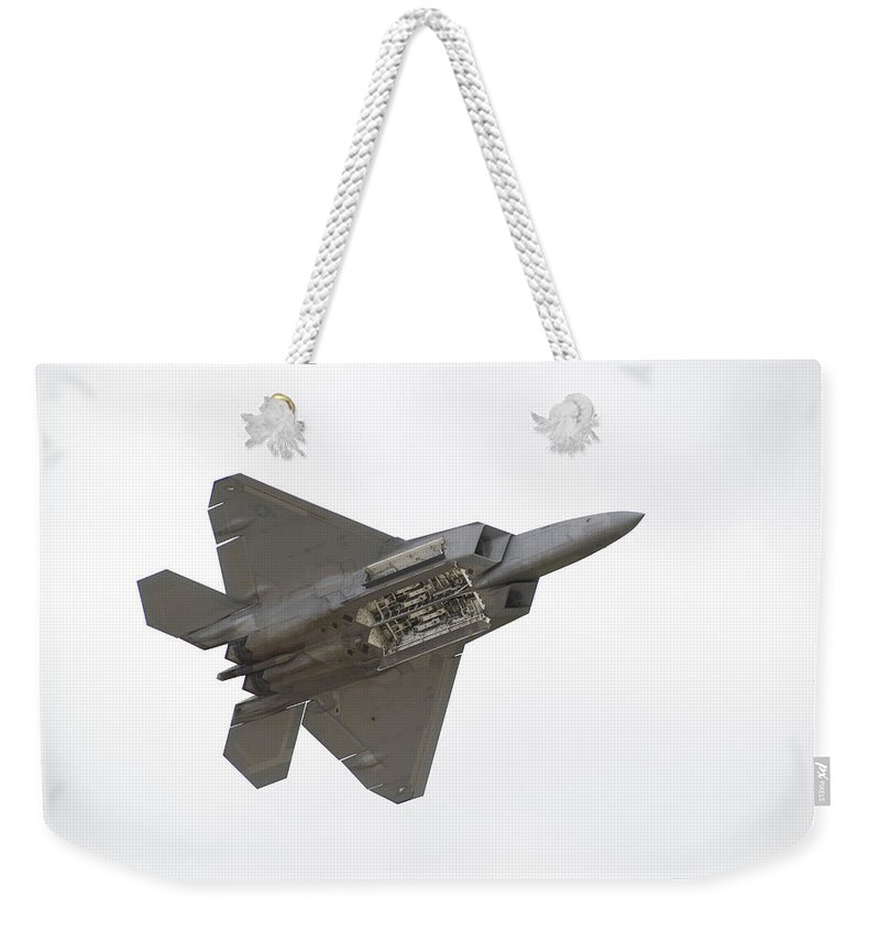 Airplane Weekender Tote Bag featuring the photograph F-22 Raptor by Sebastian Musial
