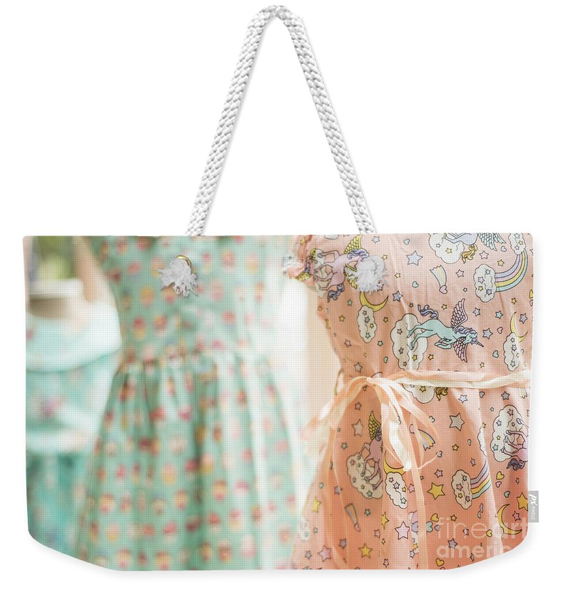 Bright Weekender Tote Bag featuring the photograph Floral Pattern Young Girl Dresses In Shop by Jacek Malipan