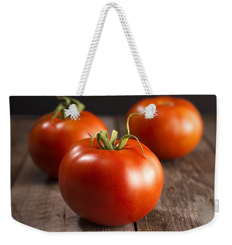 Food And Drink Weekender Tote Bag featuring the photograph Fresh Tomatoes by Donald Erickson