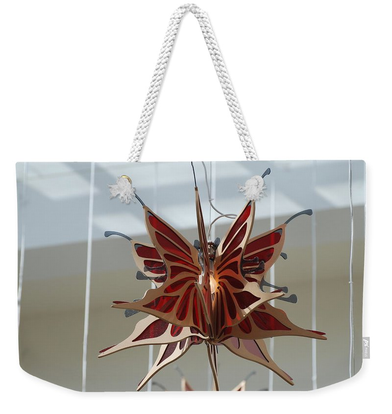 Architecture Weekender Tote Bag featuring the photograph Hanging Butterfly by Rob Hans