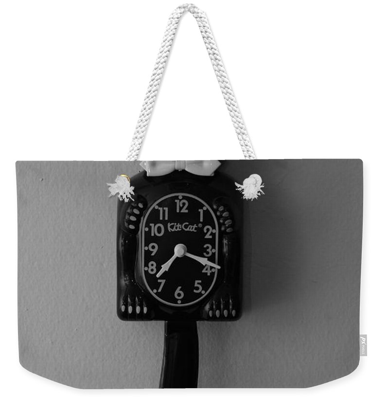 Face Weekender Tote Bag featuring the photograph Kit Cat Klock by Rob Hans