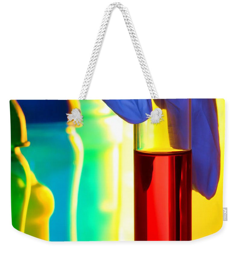 Bottles Weekender Tote Bag featuring the photograph Laboratory Test Tube In Science Research Lab by Olivier Le Queinec
