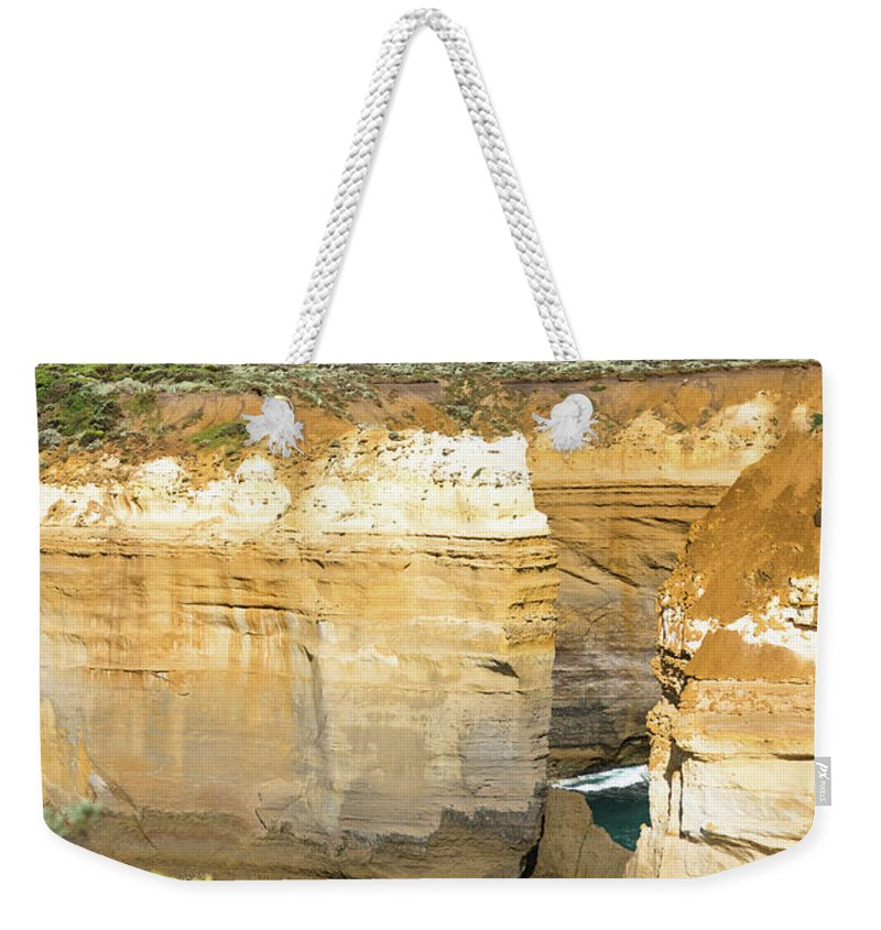 Aussie Weekender Tote Bag featuring the photograph Loch Ard Gorge by Andrew Michael