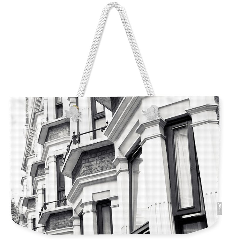 Apartments Weekender Tote Bag featuring the photograph London Houses by Tom Gowanlock