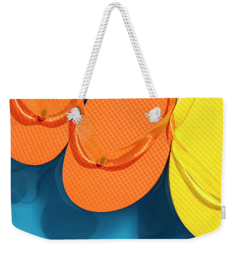 Background Weekender Tote Bag featuring the photograph Multicolored Flip Flops Floating In Pool by Jim Corwin