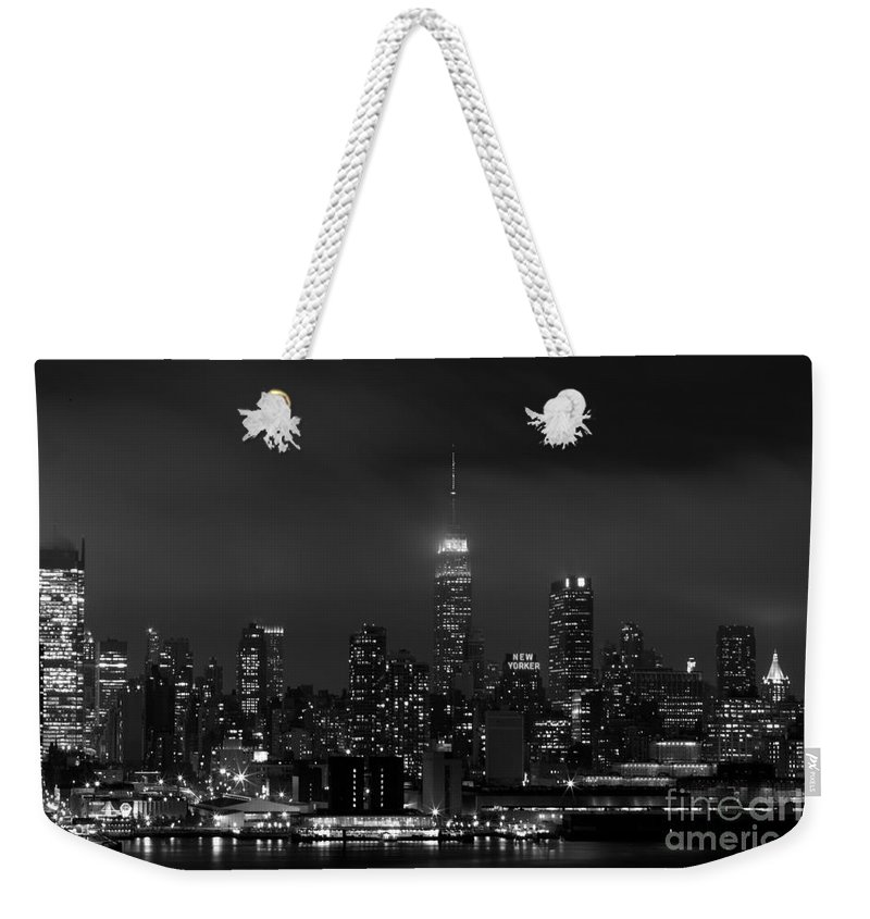 Nyc Weekender Tote Bag featuring the photograph New Yorker by MingTa Li