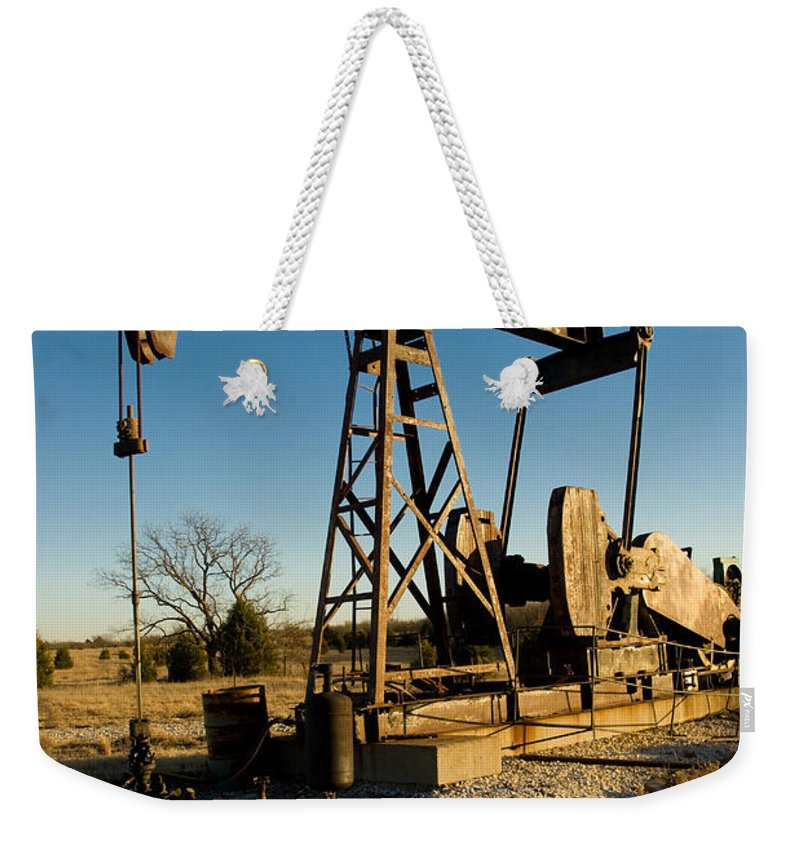 Crude Oil Weekender Tote Bag featuring the photograph Oil Rig by Anthony Totah