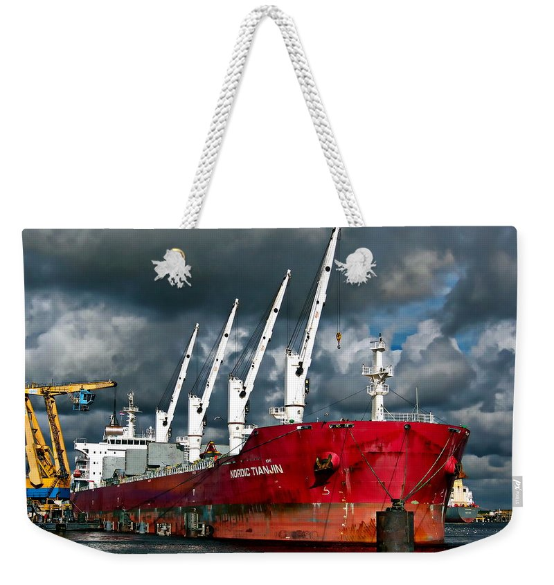 Transportation Weekender Tote Bag featuring the photograph Port Of Amsterdam by Anthony Dezenzio