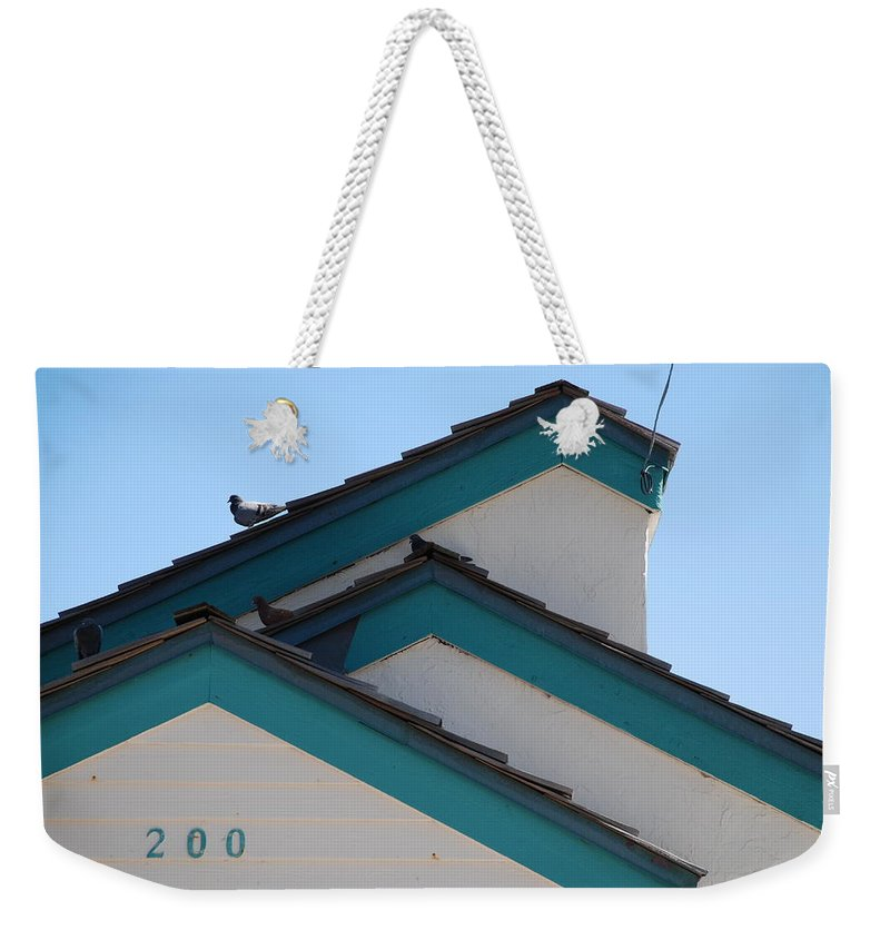 Birds Weekender Tote Bag featuring the photograph 3 Roofs by Rob Hans