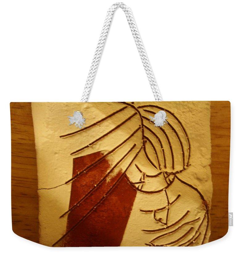 Jesus Weekender Tote Bag featuring the ceramic art Solemn - Tile by Gloria Ssali