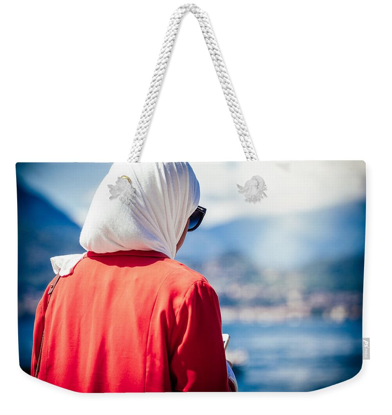 Alfio Finocchiaro Weekender Tote Bag featuring the photograph Thoughtful Women by Alfio Finocchiaro