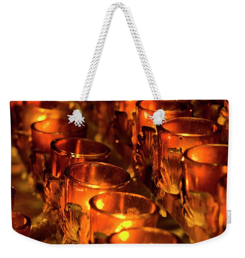 Nyc Weekender Tote Bag featuring the photograph Votive Candles. by John Greim