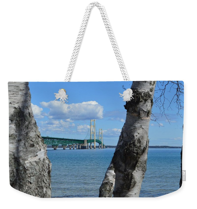 Mackinac Bridge Weekender Tote Bag featuring the photograph Between The Trees by Linda Kerkau