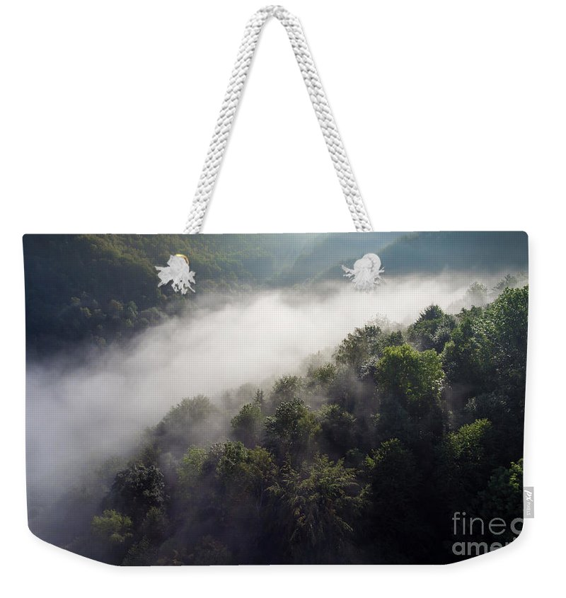 Above Weekender Tote Bag featuring the photograph Fantastic Dreamy Sunrise On Foggy Mountains by Mariusz Prusaczyk