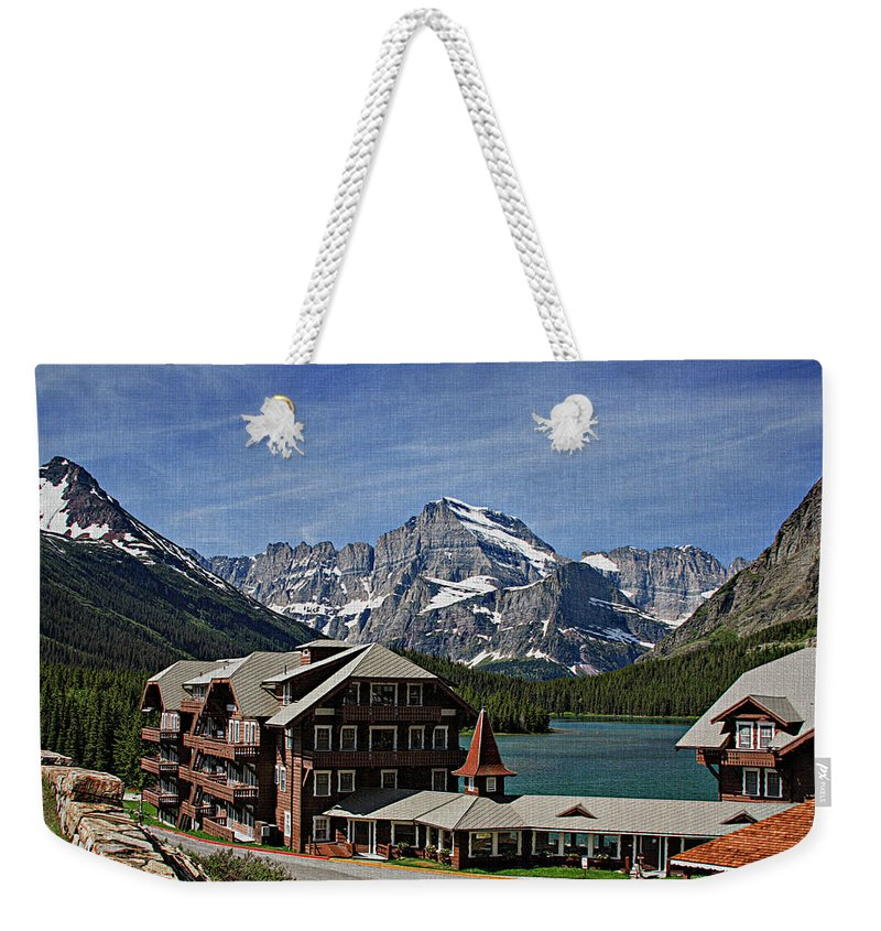 Many Weekender Tote Bag featuring the photograph Many Glacier Hotel by Margie Wildblood