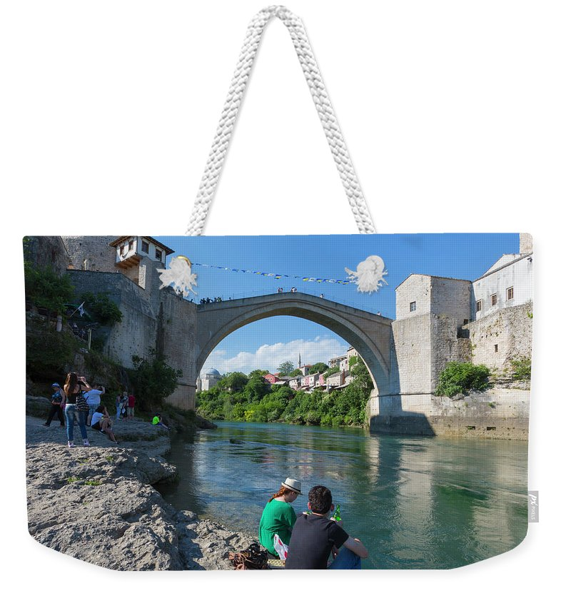 And Weekender Tote Bag featuring the photograph Mostar, Bosnia And Herzegovina by Ken Welsh
