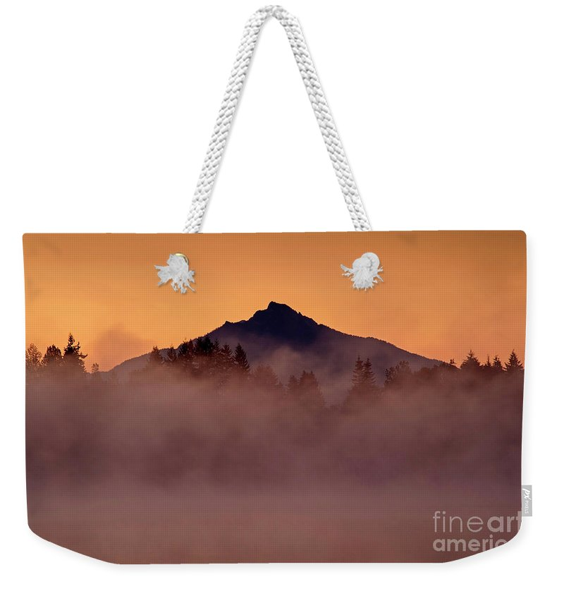 Cascade Mountain Range Weekender Tote Bag featuring the photograph Mount Pilchuck Sunrise With Fog by Jim Corwin