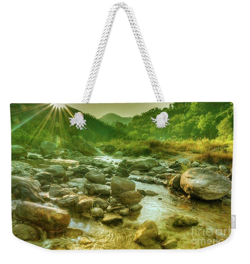 Reshi Weekender Tote Bag featuring the photograph Nice River Water Flowing Through Rocks At Dawn by Rudra Narayan Mitra