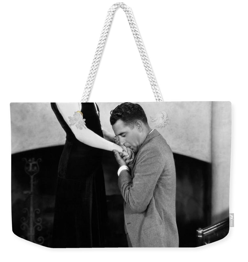 -kissing Hand- Weekender Tote Bag featuring the photograph Silent Still: Hand Kissing by Granger