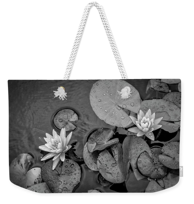 Lily Pad Weekender Tote Bag featuring the photograph 4432- Lily Pads Black And White by David Lange