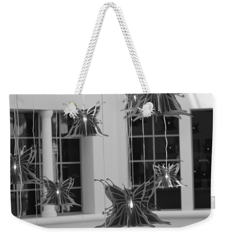 Black And White Weekender Tote Bag featuring the photograph Hanging Butterflies by Rob Hans