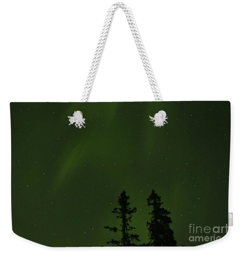 Aurora Weekender Tote Bag featuring the photograph Northern Glow by Rick Monyahan