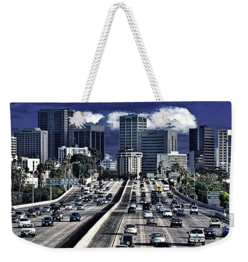 Driving Weekender Tote Bag featuring the photograph 5 Pm Downtown Next Exit by Chris Lord