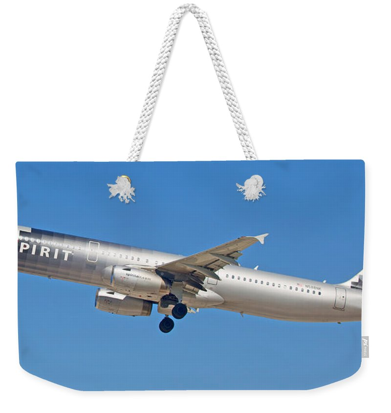 Spirit Weekender Tote Bag featuring the photograph Spirit Airline by Dart and Suze Humeston