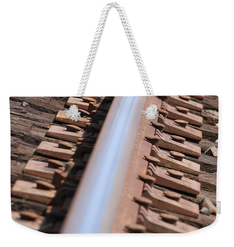 Single Weekender Tote Bag featuring the photograph Train Track by Henrik Lehnerer