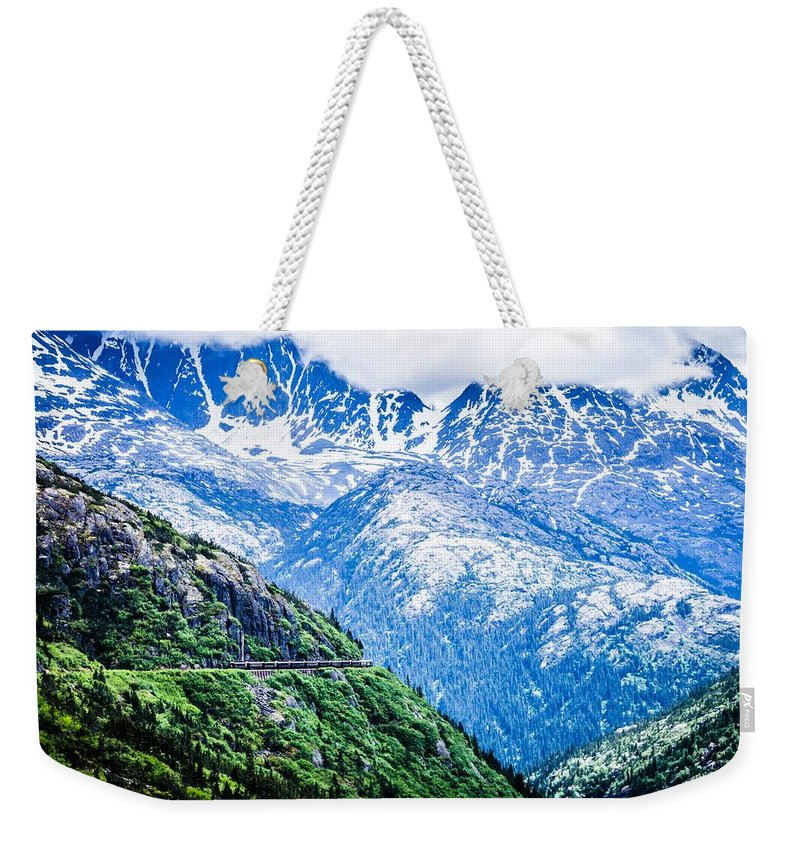Mountain Weekender Tote Bag featuring the photograph White Pass Mountains In British Columbia by Alex Grichenko