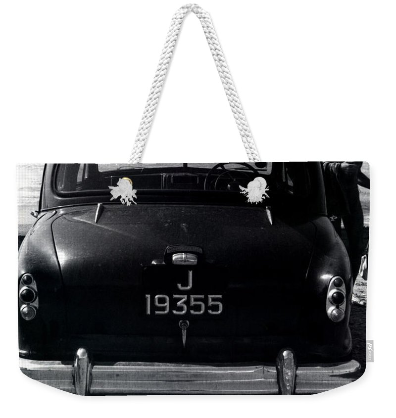 Surf Weekender Tote Bag featuring the photograph 50's Surfer by Charles Stuart