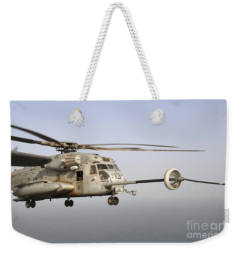 Horn Of Africa Weekender Tote Bag featuring the photograph A U.s. Marine Corps Ch-53e Super by Stocktrek Images