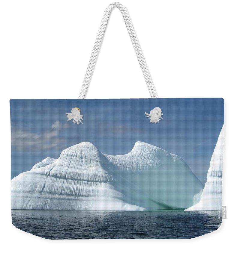 Iceberg Photograph Ice Water Ocean Sea Atlantic Summer Newfoundland Weekender Tote Bag featuring the photograph Iceberg by Seon-Jeong Kim