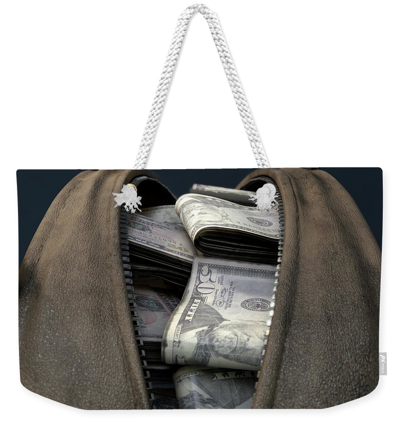 Cash Weekender Tote Bag featuring the digital art Illicit Cash In A Brown Duffel Bag by Allan Swart