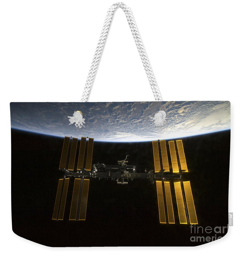 Sts-130 Weekender Tote Bag featuring the photograph International Space Station by Stocktrek Images