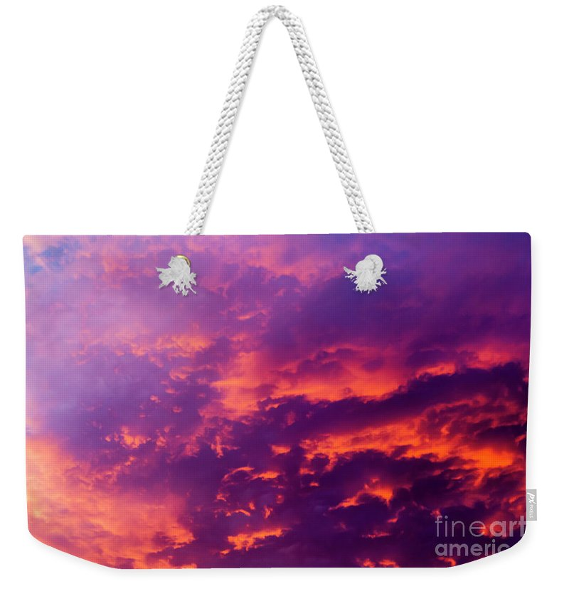 Sun Weekender Tote Bag featuring the photograph Red Cloudscape At Sunset. by Sv