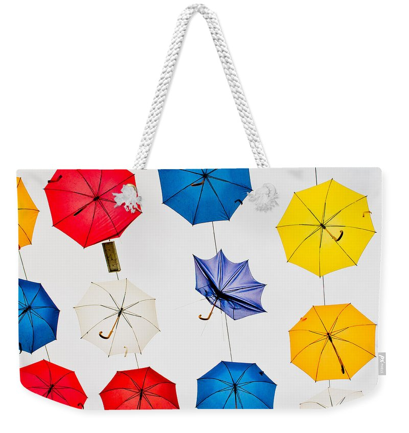 Antalya Weekender Tote Bag featuring the photograph Umbrellas by Tom Gowanlock