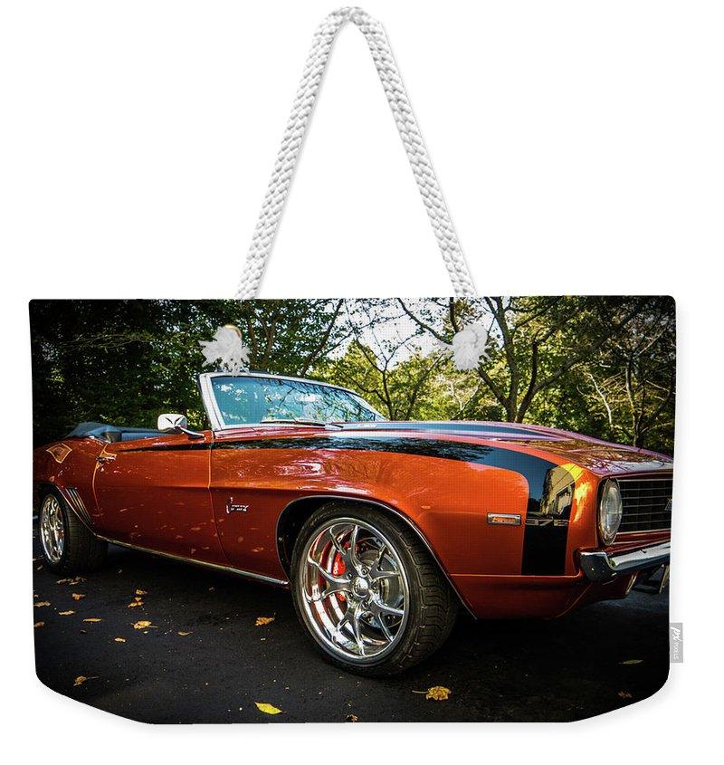 Camaro Weekender Tote Bag featuring the photograph '69 Camaro by Michael Baranowski