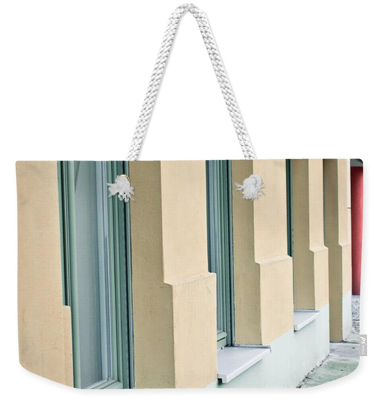Apartment Weekender Tote Bag featuring the photograph Building Exterior by Tom Gowanlock