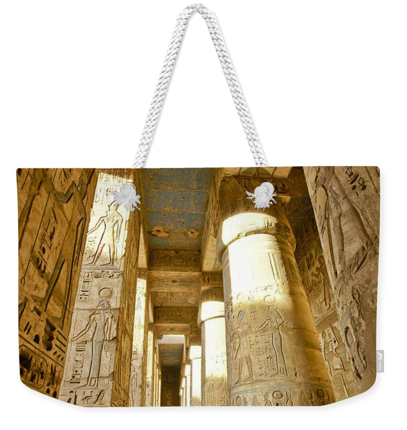 Egypt Weekender Tote Bag featuring the photograph Colonnade In An Egyptian Temple by Michele Burgess