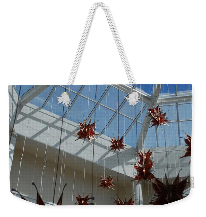 Architecture Weekender Tote Bag featuring the photograph Hanging Butterflies by Rob Hans