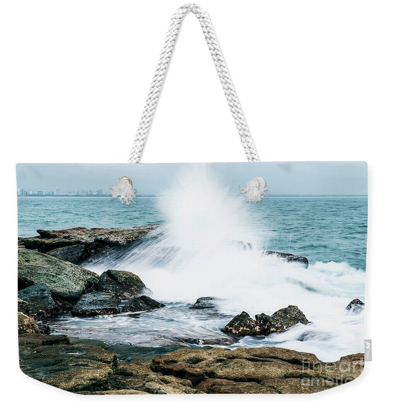 Beach Weekender Tote Bag featuring the photograph Rocks And Waves At Point Cartwright by Rob D