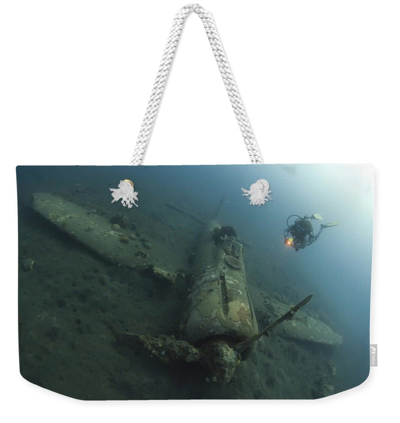 Kimbe Bay Weekender Tote Bag featuring the photograph Diver Explores The Wreck by Steve Jones