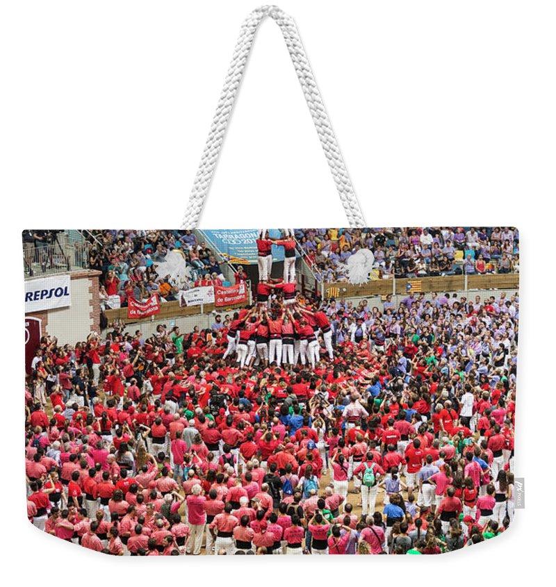 Capgrossos De Matar� Weekender Tote Bag featuring the photograph Xxvi Concurs De Castells by David Ortega Baglietto
