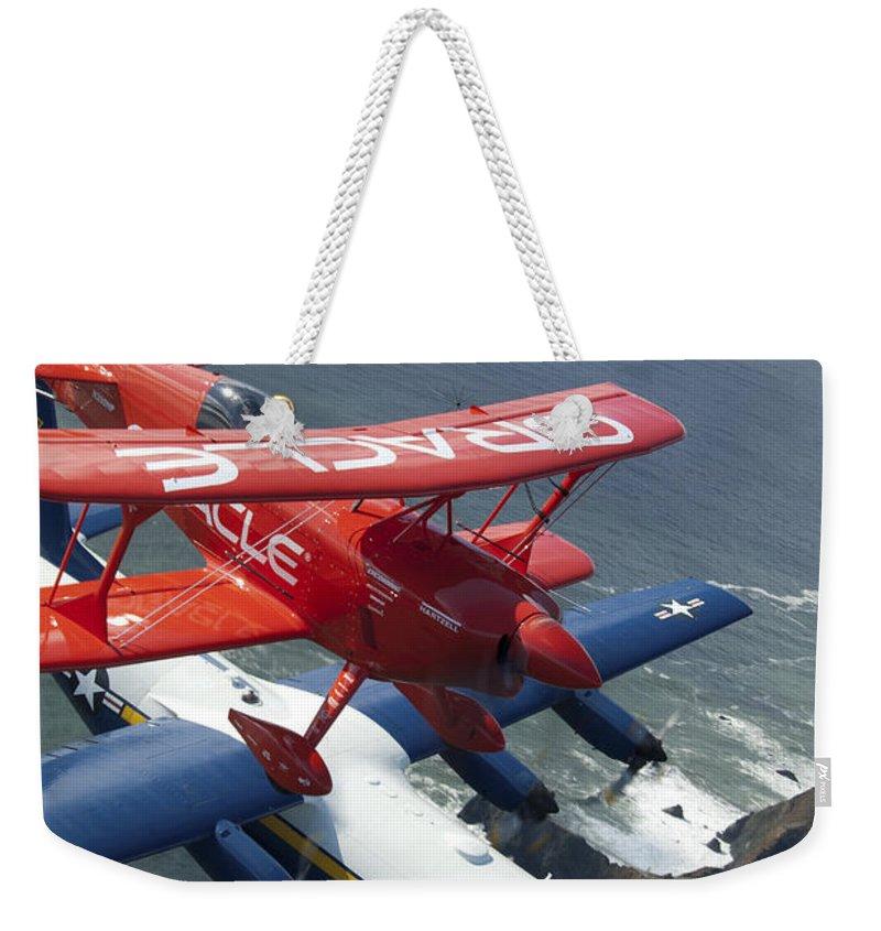 Fat Albert Weekender Tote Bag featuring the photograph A C-130 Hercules Fat Albert Aircraft by Stocktrek Images